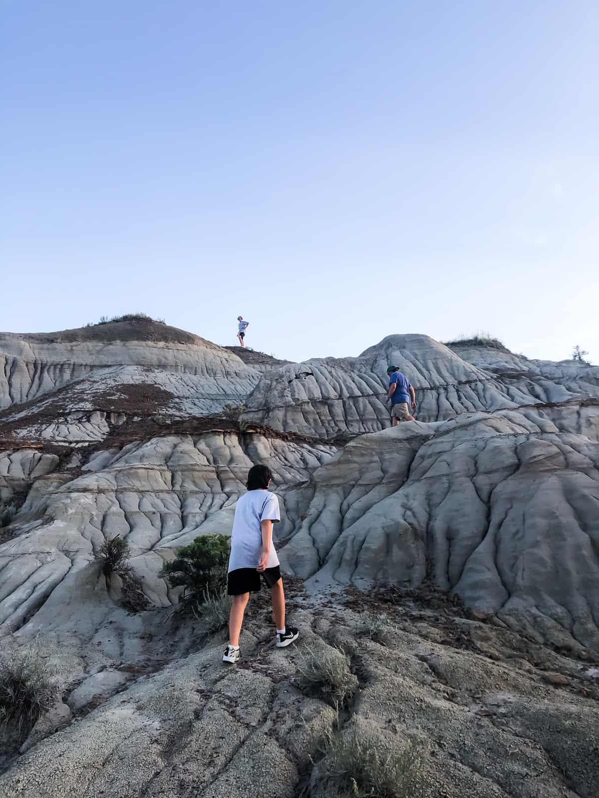 Kids climbing hoodoos